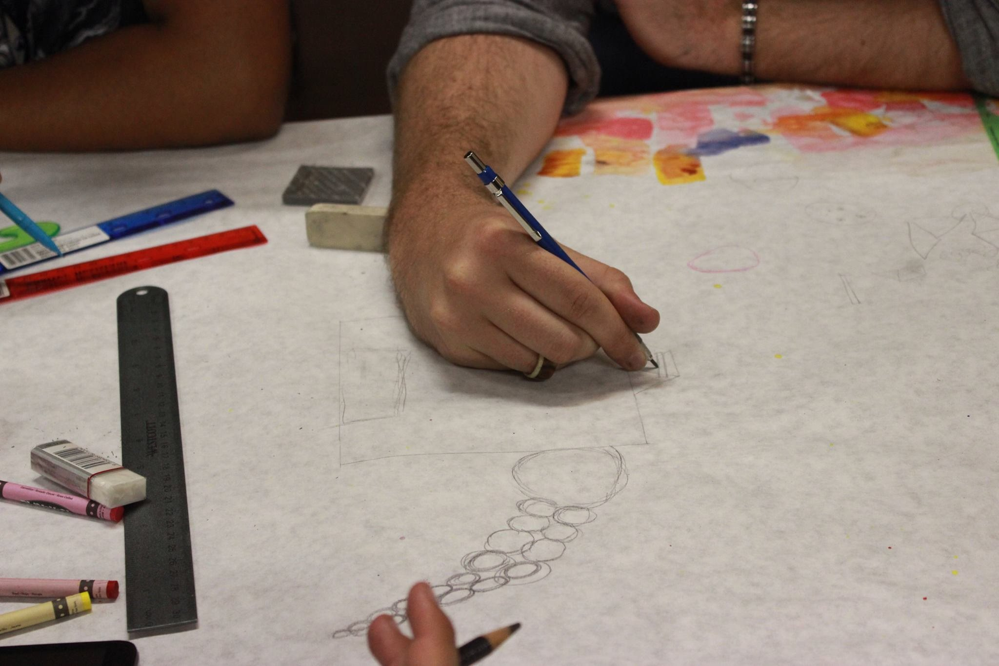 Participants Draw with Pencil Before Coloring Designs