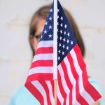 Parade Watchers Fly Their Flags