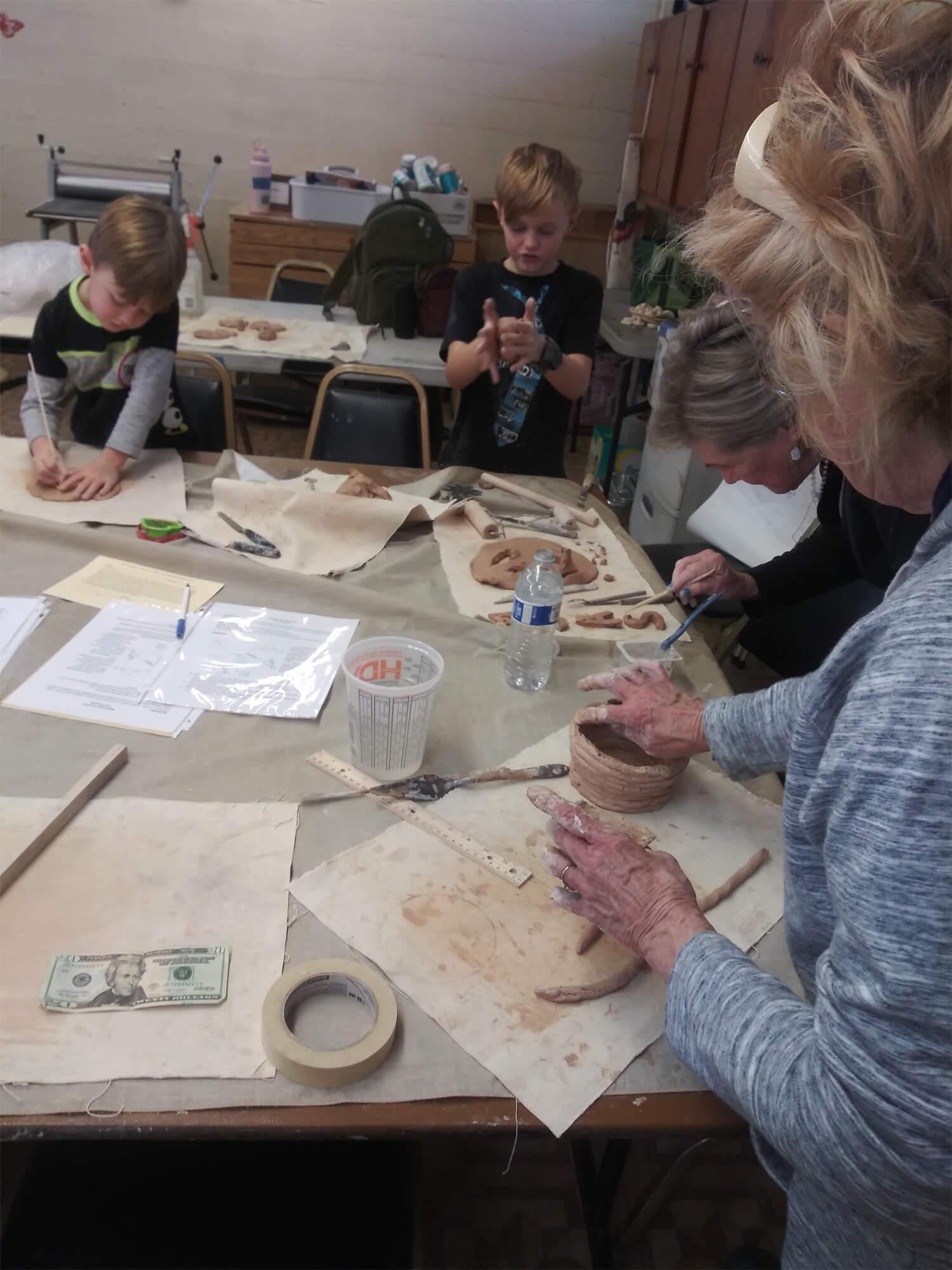Families Work on Ceramic Coil Technique