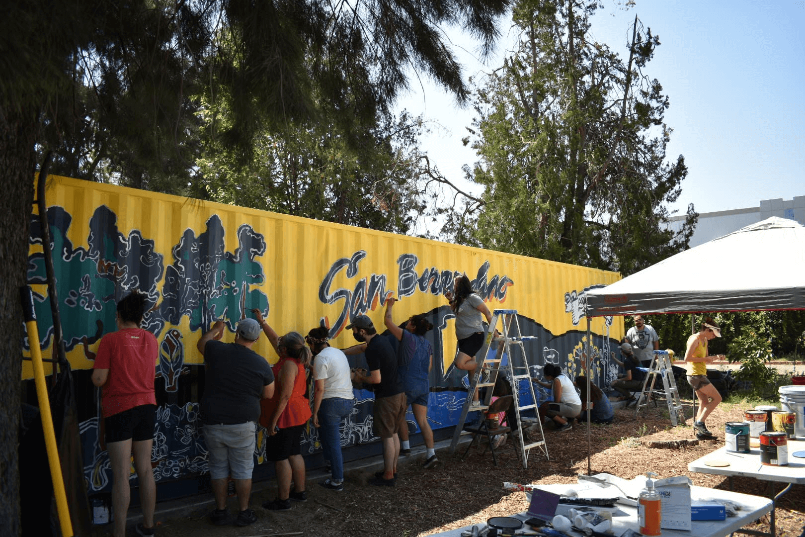 Community Members Paint Mural